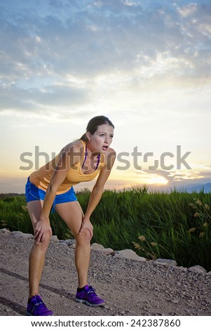 Fit female after an Early morning jog - stock photo