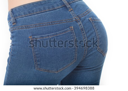 Fit female butt in blue jeans, isolated on white. Slim body. Pretty sexy woman model with amazing body. Hot buttocks. - stock photo