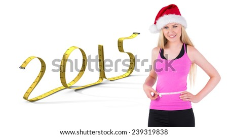 Fit festive young blonde measuring her waist against 2015 in tape - stock photo
