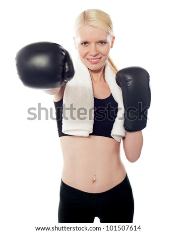 Fit girl ready to punch you hard isolated over white