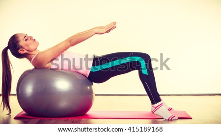 Fit girl working out. Young woman exercising in gym. Health fitness activity concept.  - stock photo