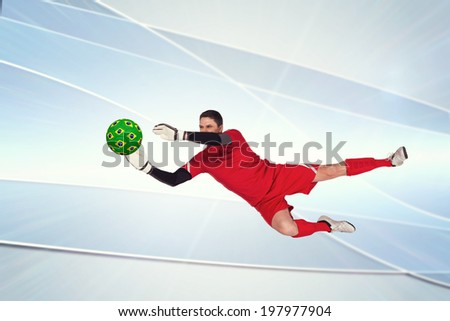 Fit goal keeper jumping up against linear grey background - stock photo