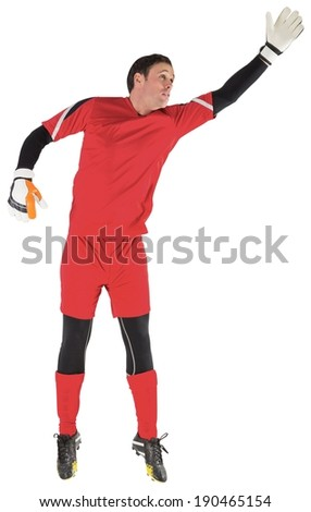 Fit goal keeper jumping up on white background - stock photo
