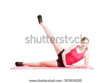 Fit, healthy and sporty woman in sportswear making physical exercises isolated on white. - stock photo