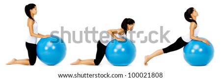 Fit healthy woman uses pilates gym ball as part of toning and muscle building training exercise. isolated on white, see portfolio for more in this series. - stock photo