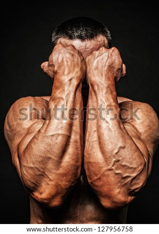 Fit male model showing his hands - stock photo