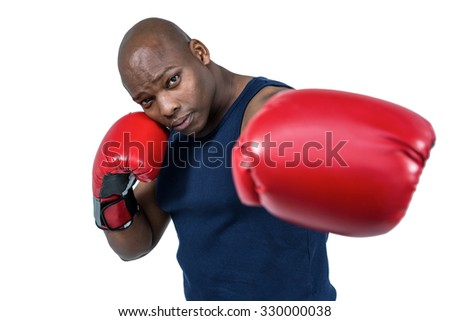 Fit man boxing with gloves on white background