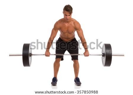 Fit Man Doing A Deadlift Exercise. Full length studio shot isolated on white. - stock photo
