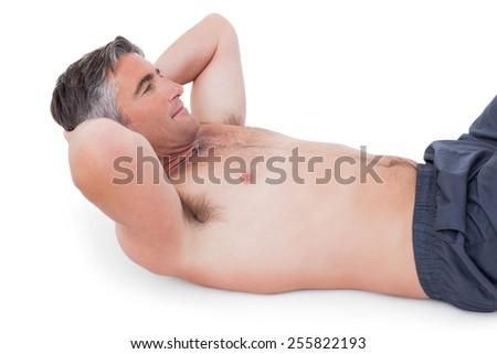 Fit man doing sit ups with no shirt on on white background