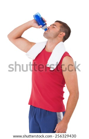 Fit man drinking water from bottle on white background