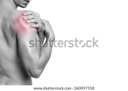Fit man holding his shoulder in pain, isolated on white background