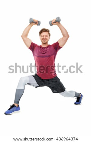 Fit man in a sportswear with dumbbells isolated on a white background. - stock photo