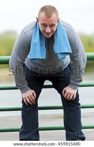 Fit man resting after jogging. - stock photo