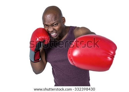 Fit man with boxing gloves on white background