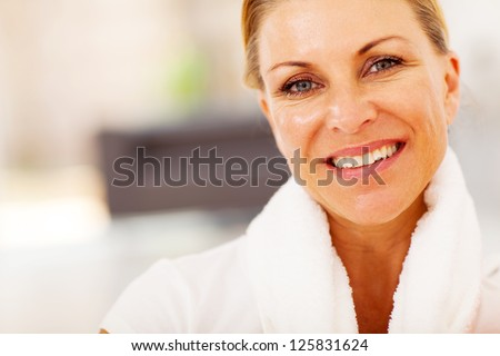 fit middle aged woman closeup portrait with towel on her neck - stock photo