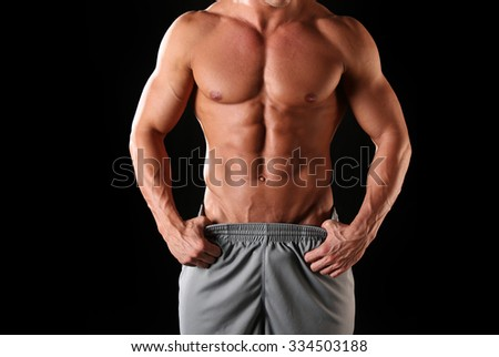 Fit, muscular and athletic male body - stock photo