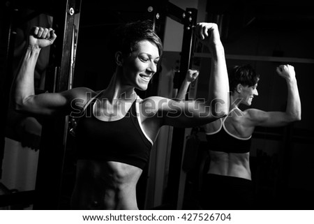fit muscular woman posing at the gym