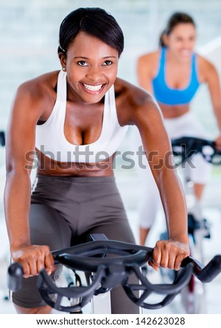 Fit people at the gym - healthy lifestyle concepts - stock photo