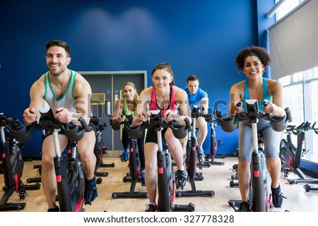 Fit people in a spin class the gym - stock photo