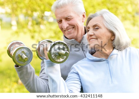 fit senior couple exercising