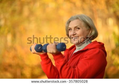 fit Senior woman exercising - stock photo
