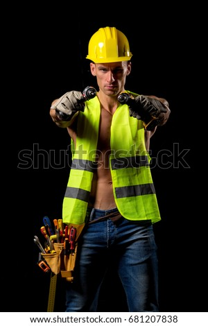 fit shirtless worker with drill and tools