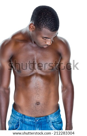 Fit shirtless young man standing over white background
