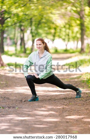 Fit sportive women stretching in the park. Healthy life and fitness concept - stock photo