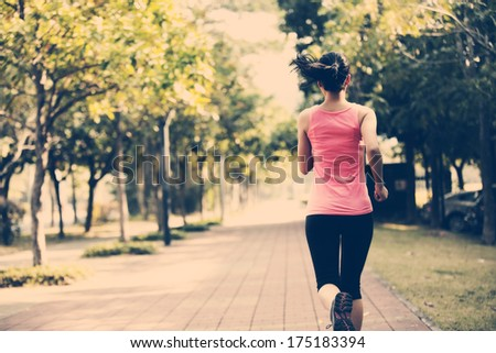 fit sports woman jogging at park - stock photo
