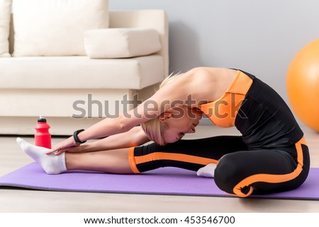 Fit sporty girl developing her flexibility - stock photo