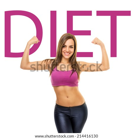Fit sporty young woman with hands raised showing her biceps smiling looking at camera wearing short purple tank-top. Caucasian fitness girl diet concept. - stock photo