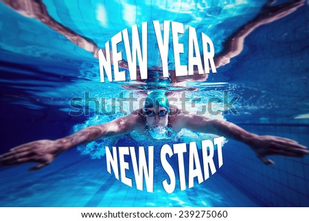 Fit swimmer training by himself against new year new start - stock photo