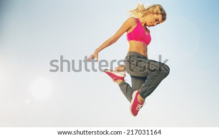 Fit woman doing exercises - stock photo