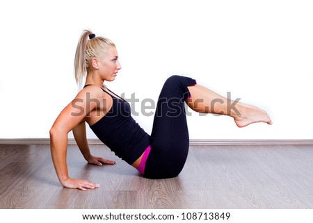 fit woman doing sit-ups exercise abdominal workout