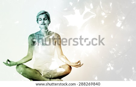 Fit woman doing yoga against autumnal leaves and sunlight Fit woman doing yoga on white background - stock photo