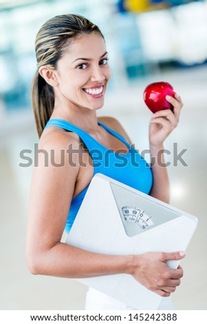 Fit woman eating healthy to lose weight - stock photo