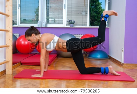 fit woman in fitness salon in stretching pose exercise - stock photo