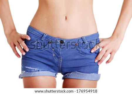Fit woman in jeans shorts - stock photo