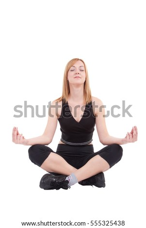 Fit woman is practicing yoga isolated on white background