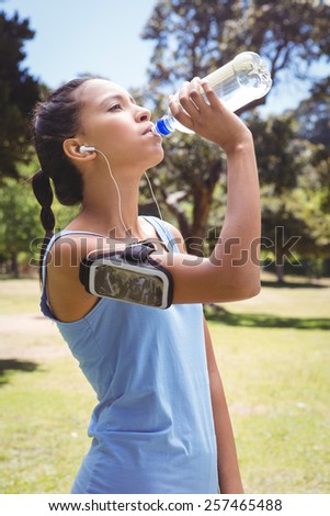 Fit woman jogging in the park on a sunny day