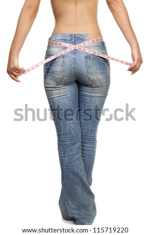 Fit woman measuring her waist - isolated over a white background