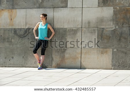 Fit woman resting after run in the city. Jogger.