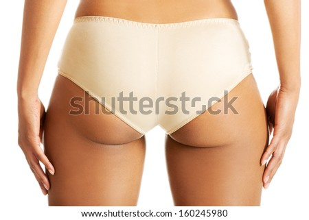 Fit woman's buttocks in panties. Isolated on white.  - stock photo