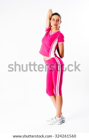 Fit woman stretching her shoulder girdle to warm up - isolated over white background - stock photo