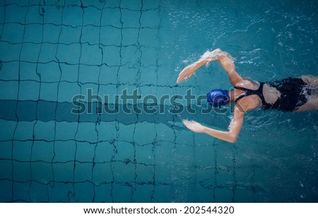 Fit woman swimming in the pool at the leisure center - stock photo