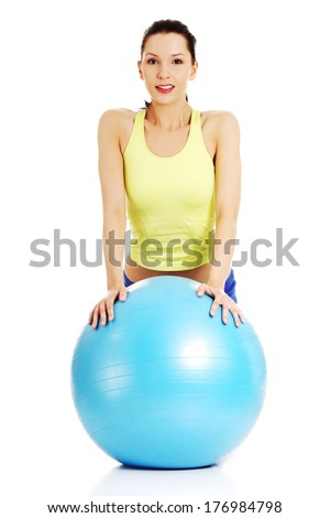 Fit woman with fitness ball , isolated on white