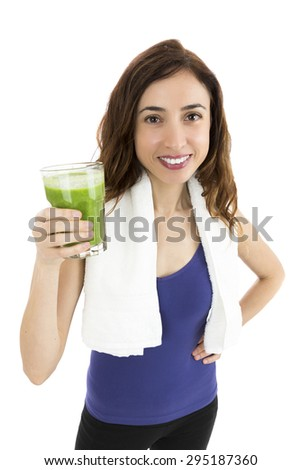 Fit woman with green smoothie - stock photo