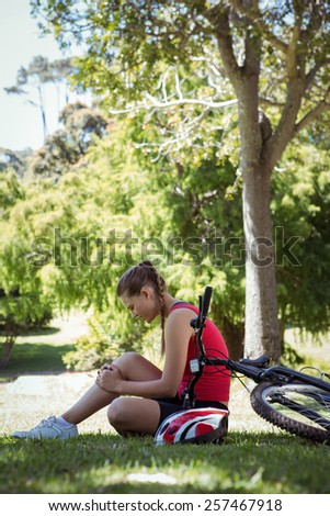 Fit woman with her bike on a sunny day - stock photo