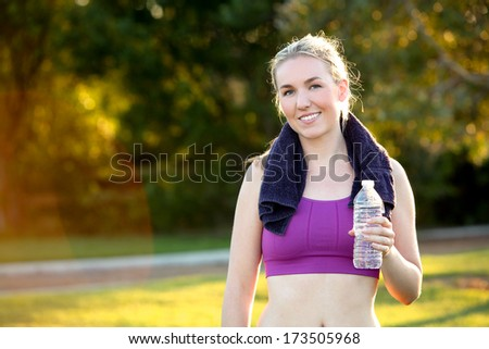 Fit woman with towel and water bottle