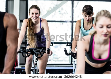 Fit women working out at class in the gym